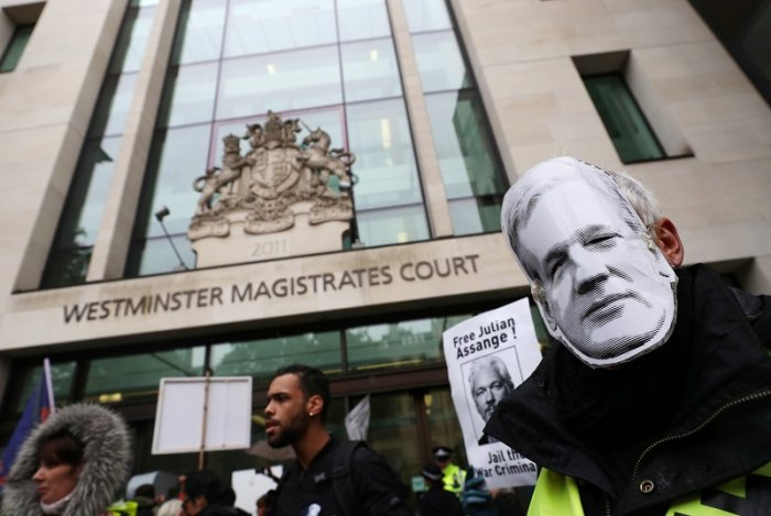 Demonstrators hold banners during a protest outside of Westminster Magistrates Court, where a case management hearing in the U.S. extradition case of WikiLeaks founder Julian Assange is held, in London, Britain. (Reuters Photo)
