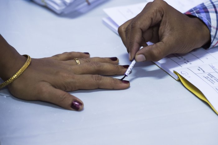 A woman has her finger marked with ink after casting her vote at a polling station during the State Assembly election in Mumbai. (AFP Photo)