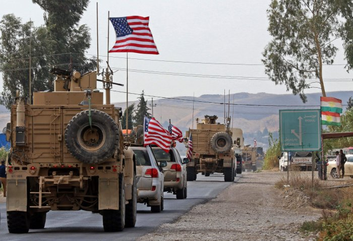 A convoy of US military vehicles arrives near the Iraqi Kurdish town of Bardarash in the Dohuk governorate after withdrawing from northern Syria. (AFPP Photo)