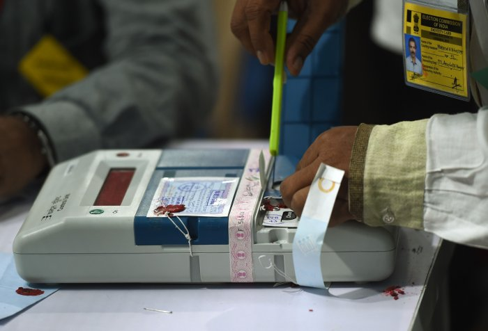 An Indian official inspects an Electronic Voting Machine (EVM) during a votes counting process at a booth in Mumbai. (AFP Photo)