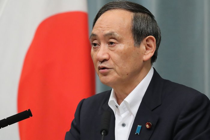 Japan's Cabinet Secretary Yoshihide Suga speaks during a press conference, after 6.8-magnitude earthquake hit the northwest of Japan, at the prime minister's official residence in Tokyo. (AFP Photo)