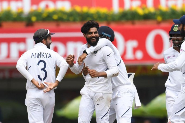 India's Ravindra Jadeja (C) celebrates with teammates after bowling out South Africa's Heinrich Klaasen (not pictured) during the third day of the third and final Test match between India and South Africa at the Jharkhand State Cricket Association (JSCA) stadium in Ranchi on October 21, 2019. (Photo by Money SHARMA / AFP)
