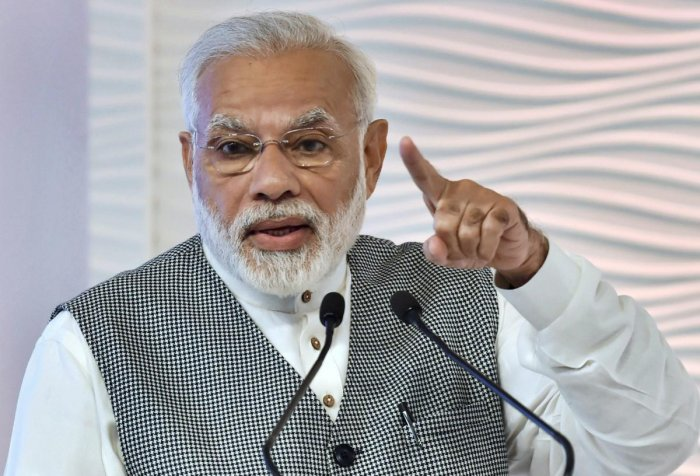It is usual for PM Modi to use social media to urge voters to cast their votes on election days. Photo/PTI