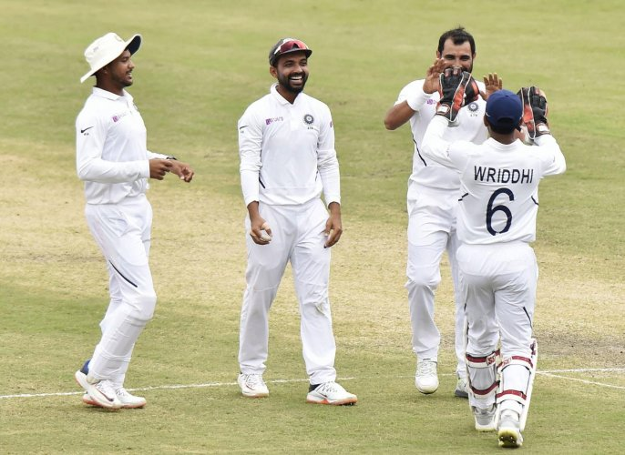 Indian bowler Mohammed Shami celebrates with teammates the wicket of South Africa's Dane Piedt during day 3 of the 3rd cricket test match at JSCA Stadium in Ranchi,Monday, Oct. 21, 2019. (PTI Photo/Ashok Bhaumik)