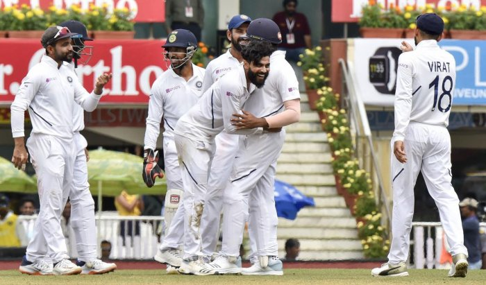 Indian player Ravindra Jadeja celebrates with teammates the dismissal of South Africa batsman Heinrich Klaasen during the third day of third and last cricket test match between India and South Africa, at JSCA Stadium in Ranchi, Monday, Oct. 21, 2019. (PTI Photo/Ashok Bhaumik)
