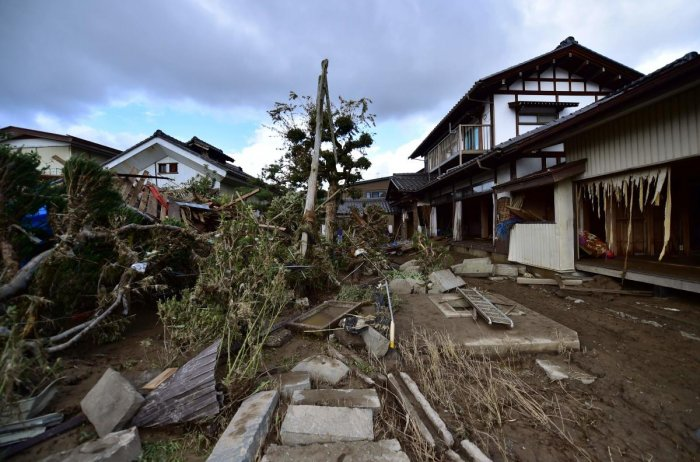This picture taken on October 15, 2019 shows a flood-damaged house in Nagano, after Typhoon Hagibis hit Japan on October 12 unleashing high winds, torrential rain and triggered landslides and catastrophic flooding. (AFP)