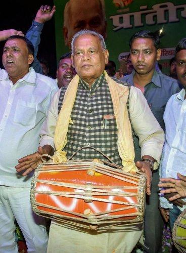 Former Bihar Chief Minister and Hindustani Awam Morcha (HAM) party president Jitan Ram Manjhi is beats a 'dhol' during Prantiya Musahar-Bhuiya Sammelan in Patna on Sunday. (PTI Photo)