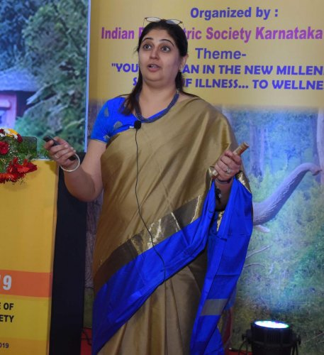 Dr Alka Subrahmanyam, a psychiatrist from Mumbai, speaks at the conference in Madikeri on Sunday.
