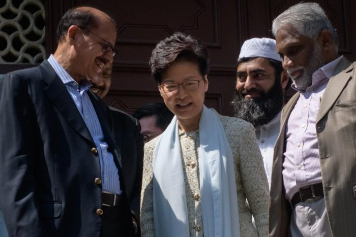 Hong Kong's Chief Executive Carrie Lam (C) exits the Kowloon Mosque, or Kowloon Masjid and Islamic Centre, in the Tsim Sha Tsui district in Hong Kong. AFP