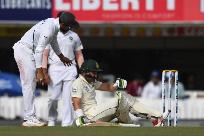 South Africa's Dean Elgar (C) sits on the floor after being hit by a ball during the third day of the third and final test match between India and South Africa at Jharkhand State Cricket Association (JSCA) in Ranchi on October 21, 2019. (AFP)