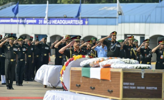Vice-Chief of Army Staff Gen. M M Naravane along with Indian Army personnel pay tributes to martyrs Hawaldar Padam Bahadur Shrestha (Assam) & Rifleman Gamil Kumar Shrestha at Palam Delhi Tech Area in New Delhi on Monday. (PTI Photo)