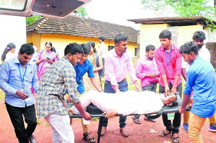 A patient being brought in a stretcher to the polling station at Paivalike to exercise franchise.