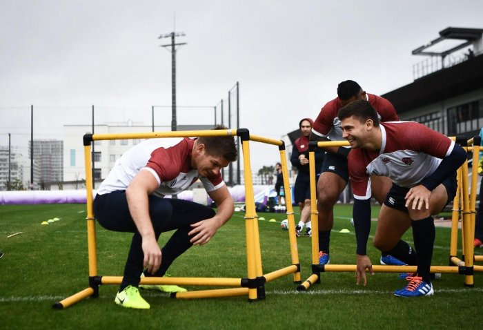 England's centre Owen Farrell (L) and England's scrum-half Ben Youngs (R) take part in a training session at the Arcs Urayasu Park in Urayasu on October 22,2019 during the Japan 2019 Rugby World Cup. (Photo by Anne-Christine POUJOULAT / AFP)