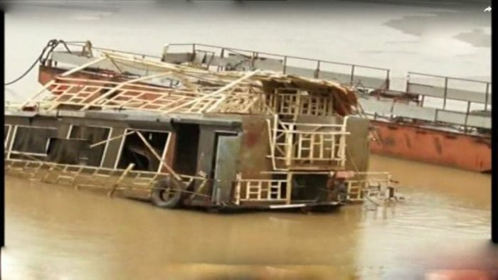 The Royal Vasishta boat after it surfaced and TV grab of Dharmadi Satyam speaking with media.