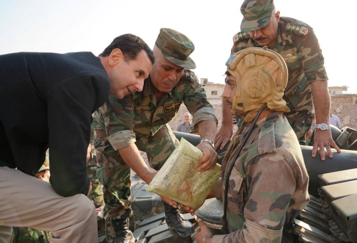 Syrian President Bashar al Assad visits Syrian army troops in war-torn northwestern Idlib province, Syria, in this handout released by SANA. Reuters/SANA