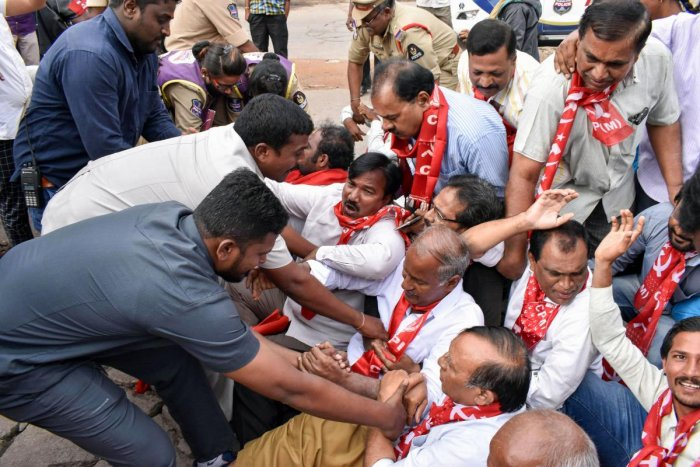 Left party activists supporting Telangana State Road Transport Corporation employees during a protest at their ongoing strike. (PTI Photo)