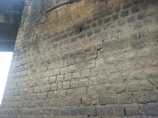 The bridge built across Bhadra backwaters at Menasooru village has developed cracks.