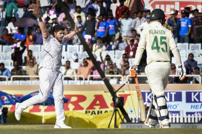 Indian bowler Umesh Yadav celebrates the dismissal of South Africa batsman Heinrich Klaasen during the third day of third and last cricket test match between India and South Africa. (PTI Photo)