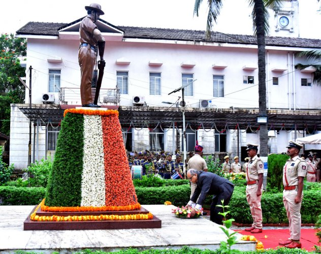 Sessions Judge Kadlooru Satyanarayanacharya pays floral tributes to police martyrs at the memorial in the district police ground inMangaluru on Monday.