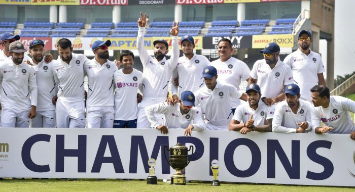 Indian captain Virat Kohli and team players pose with the trophy after winning the Test series against South Africa at JSCA Stadium, in Ranchi, Tuesday, Oct. 22, 2019. PTI