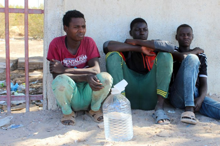 Migrants are seen on the street, after being rescued by the Libyan coast guard, in Misrata, Libya. Reuters