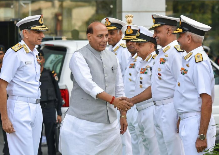 Defence Minister Rajnath Singh is greeted as he arrives for the Naval Commanders conference, in New Delhi, Tuesday, Oct. 22, 2019. Also seen is Indian Navy Chief Admiral Karambir Singh. Photo/PTI