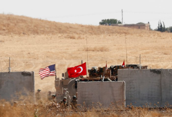 Turkish and U.S. troops return from a joint U.S.-Turkey patrol in northern Syria, as it is pictured from near the Turkish town of Akcakale, Turkey. (Reuters Photo)