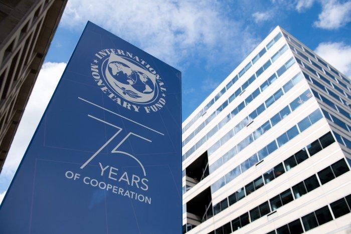 World Bank Annual Meetings hang outside International Monetary Fund Headquarters in Washington. (AFP Photo)