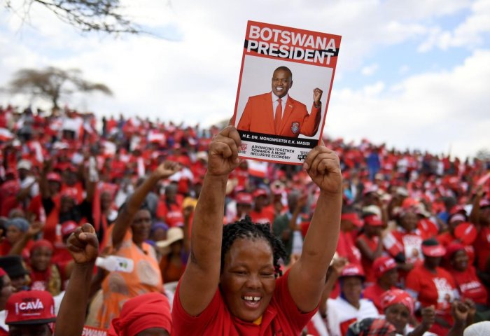 A Botswana Democratic Party (BDP) supporter holds up a poster during an election campaign rally in Mokgweetsi Masisi's, President of Botswana and leader of the BDP, home village in Moshupa, on October 22, 2019. AFP photo