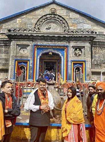 Maharashtra Chief Minister Devendra Fadnavis and his wife Amruta Fadnavis during their visit to Kedarnath Temple in Uttarakhand. (Twitter/PTI Photo)