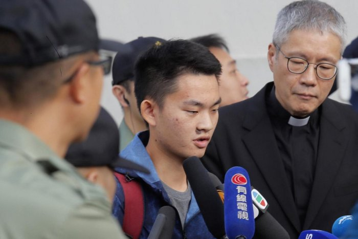 Chan Tong-kai, center, talks to the media as he is released from prison in Hong Kong Wednesday, Oct. 23, 2019. AP/PTI Photo
