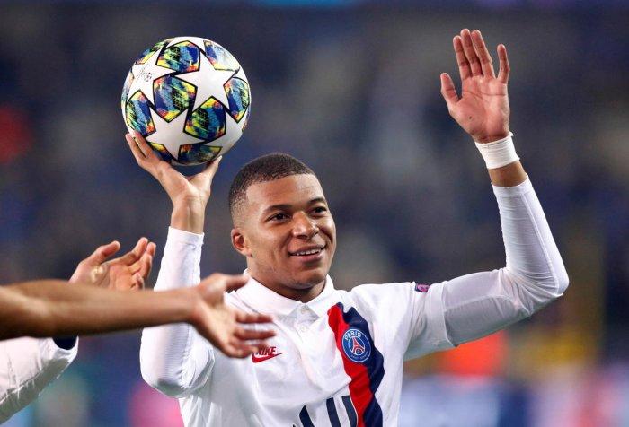 Paris St Germain's Kylian Mbappe celebrates after the match with the match ball. REUTERS/Francois Lenoir