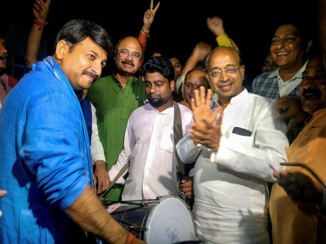 Delhi BJP President Manoj Tiwari and party MP Vijay Goel celebrate after Union Cabinet granted ownership rights to people living in unauthorised colonies in Delhi, in New Delhi on Wednesday. (PTI Photo)