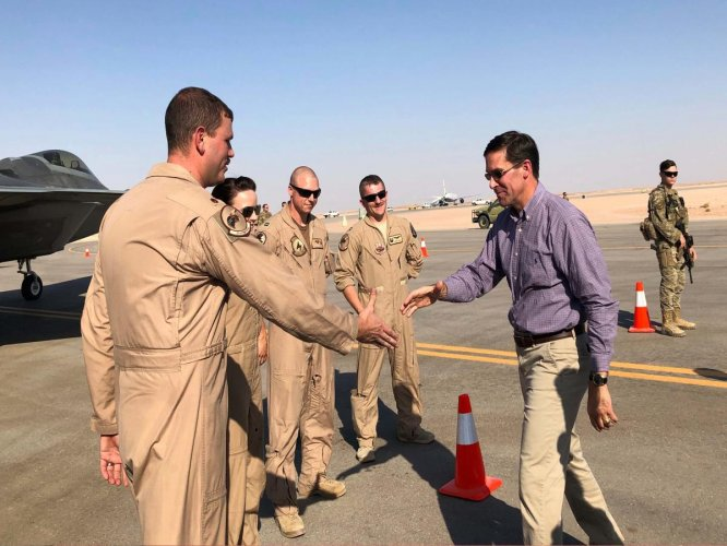 Defense Secretary Mark Esper talks with U.S. troops in front of an F-22 fighter jet deployed to Prince Sultan Air Base in Saudi Arabia, Tuesday, Oct. 22, 2019. AP/PTI Photo
