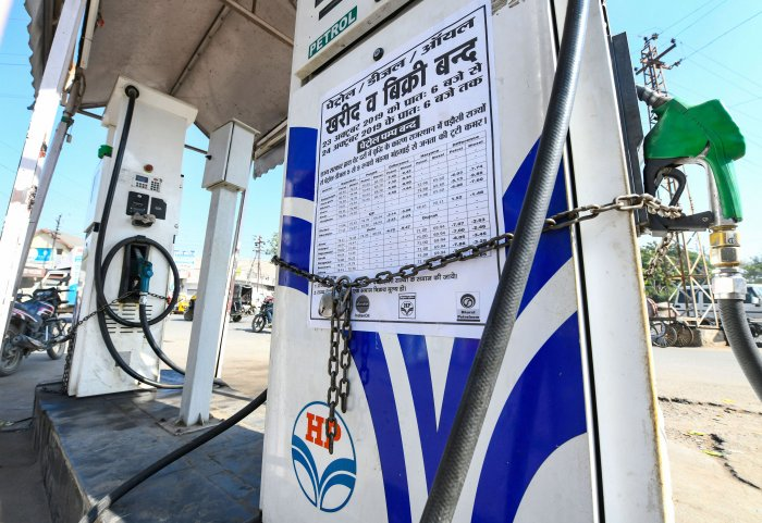 A notice is stuck on a closed petrol pump during a strike called by Rajasthan Pump Dealers Association against VAT rate, in Beawar. (PTI Photo)