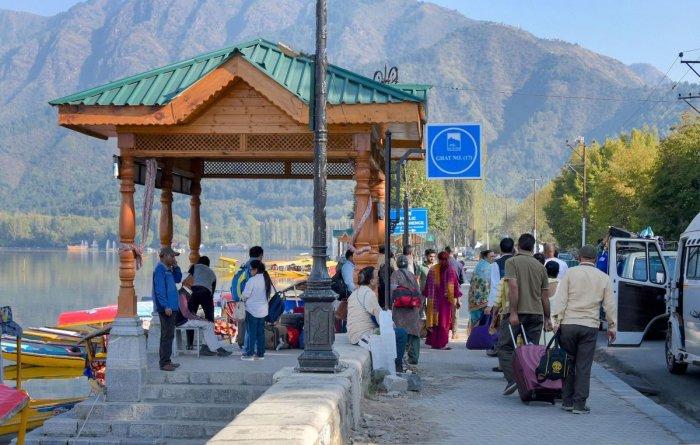 File  PTI photo of tourists seen near the famous Dal Lake in Srinagar