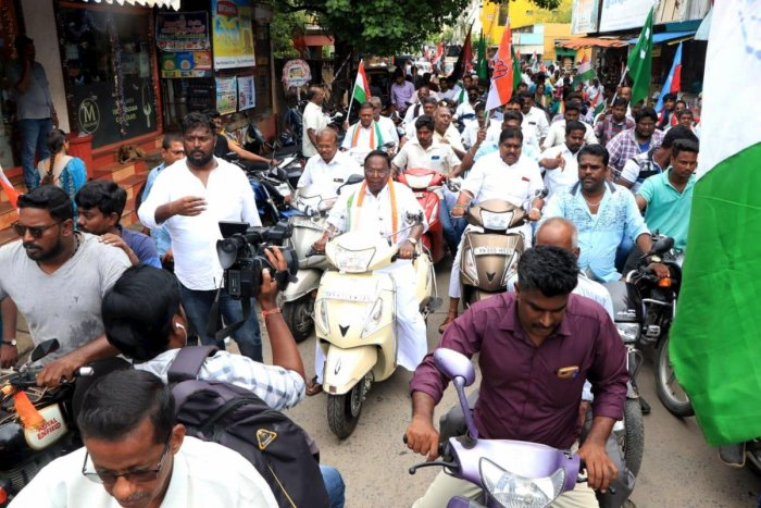 File PTI photo Puducherry Chief Minister V Narayanasamy (C) leads a two-wheeler rally in support of Congress by-poll candidate from Kamaraj Nagar legislative