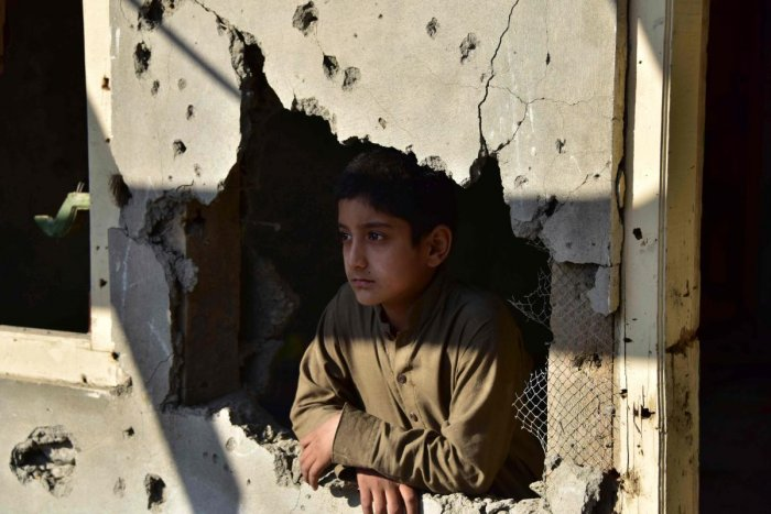 A Kashmiri boy looks out from his damaged family house after cross border shelling in Jura, a village of Neelum valley in Pakistan-administered Kashmir. (Photo by Reuters)