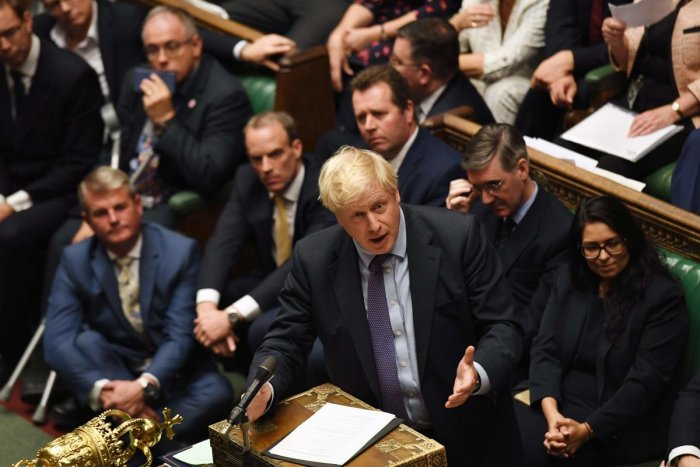 A handout picture released by the UK Parliament shows Britain's Prime Minister Boris Johnson (C) speaking in the House of Commons in London on October 22, 2019, after members of parliament approved in principal the Brexit Withdrawal Agreement Bill but rejected the proposed timetable. (AFP PHOTO / UK PARLIAMENT / JESSICA TAYLOR)