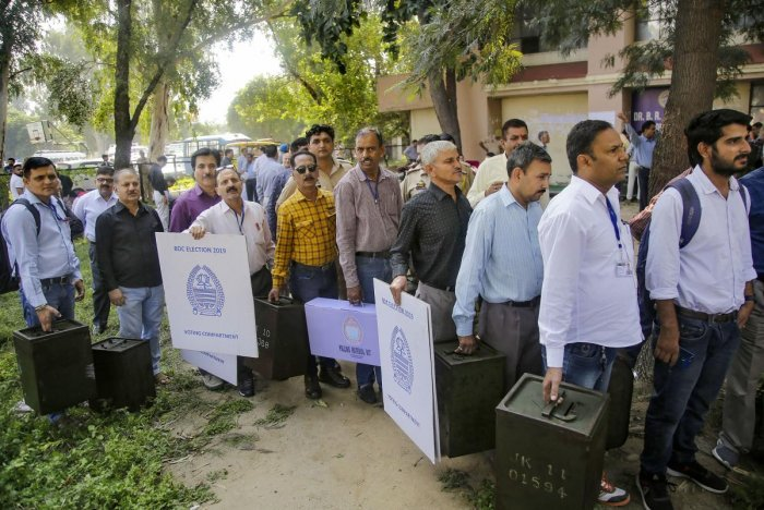 Polling officials carry ballot boxes and election material before leaving for the polling stations on the eve of Block Development Councils (BDC) elections, in Jammu, Wednesday, Oct. 23, 2019. (PTI Photo)