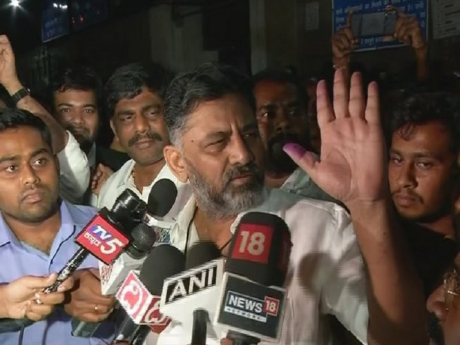 Shivakumar, who was in jail for last 50 days, soon after coming out from the jail complex, waved at his followers and hugged his brother Congress MP D K Suresh. (DH Photo)