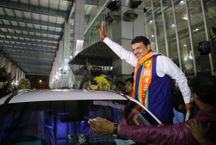 Maharashtra CM Devendra Fadnavis being welcomed by party workers at Nagpur airport, Thursday, Oct. 24, 2019. (PTI Photo)
