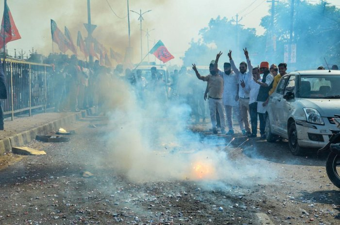 BJP supporters burn crackers to celebrate the victory of the party candidate from Kanpur Assembly seat, Surendra Maithani at Govind Nagar in Kanpur, Thursday, Oct. 24, 2019. (PTI Photo)