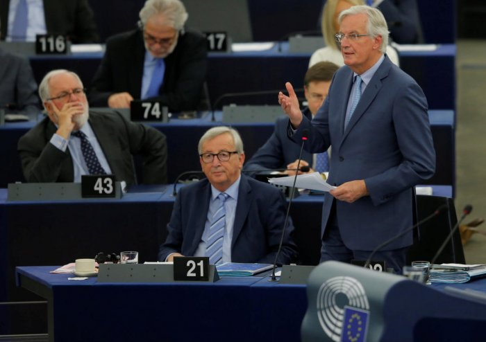 European Commission President Jean-Claude Juncker and European Union's chief Brexit negotiator Michel Barnier attend a debate on the last EU summit and Brexit at the European Parliament in Strasbourg, France, October 22, 2019. REUTERS/Vincent Kessler