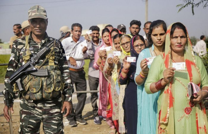 Panches and Sarpanches stand in a queue to cast their votes for Block Development Councils (BDCs) elections in Jammu (PTI Photo)
