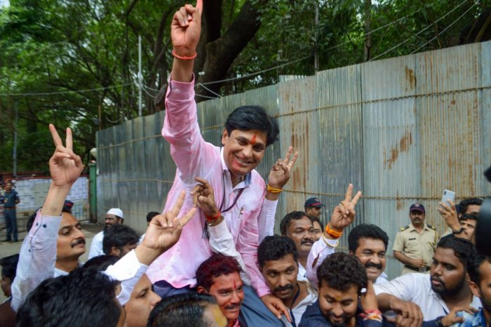 Chetan Tupe, NCP wining candidate from Hadapsar constitiency gestures at an election vote counting centre in Pune, Thursday, Oct. 24, 2019. (PTI Photo)