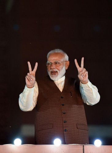 Prime Minister Narendra Modi arrives to address his supporters after the party's victory in both Haryana and Maharashtra Assembly polls