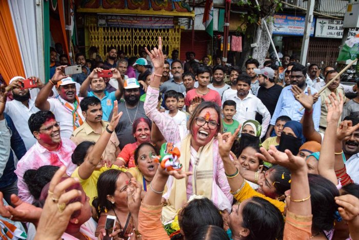 Congress candidate from Dharavi Varsha Gaikwad celebrates her victory in Assembly elections in Mumbai onThursday. (PTI Photo)