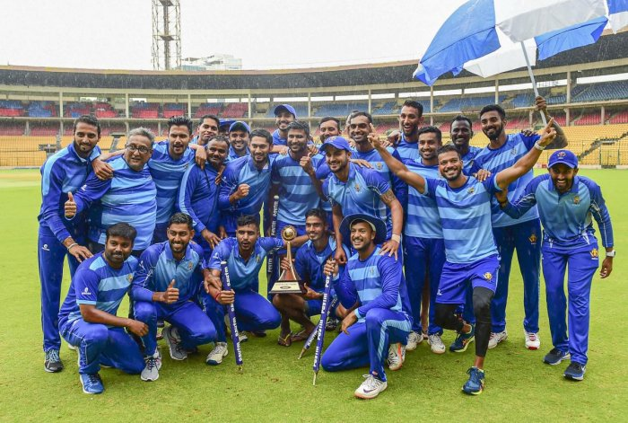 Karnataka team celebrates with the trophy after their victory against Tamil Nadu in the finals of the Vijay Hazare Trophy tournamentg in Bengaluru, Friday, Oct. 25, 2019. (PTI Photo)