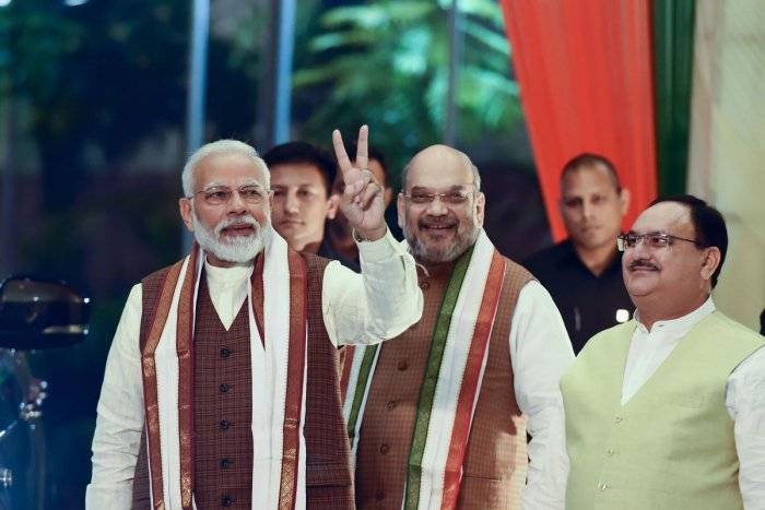 Prime Minister Narendra Modi arrives to address his supporters at the BJP headquarters in New Delhi on Thursday. PTI
